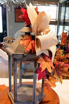The popularity of lanterns has been growing by leaps and bounds over the last few years. They are an instant centerpiece and easy focal poin. Fall Lantern Centerpieces, Fall Lanterns, Lanterns Decor, Decorative Lanterns, Diy Lantern, Centrepieces, Kelly Wearstler, Plywood Furniture, Thanksgiving Decorations