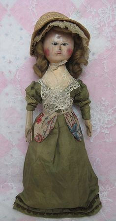 This fabulous and fine George III wooden doll has carved ears and retains her original painted finish. Victorian Dolls, Antique Dolls, Vintage Dolls, Wooden Pegs, Wooden Dolls, Old Fashion Dresses, Blush On Cheeks, Old Dolls, Little Doll