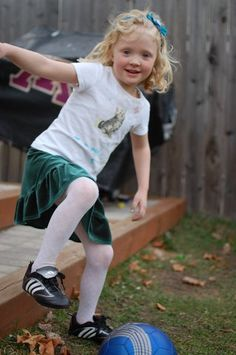 My daughter.  Velvet skirt, tights and ... soccer cleats.