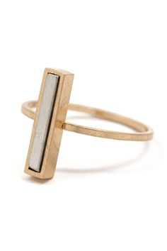 The subtle power of this two-toned bar ring translates into some seriously sleek style. The minimalist bar lays parallel along your finger, creating an effortless way to change up the look of your rin