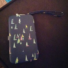 ⬇REDUCED⬇iPhone 5c/5s 2in1 Case&Wallet Blue iPhone 5c/5s case and wallet clutch. Comes with velcro strap to hold in your phone and a cut out on bottom to press your home button. Also has a hand strap to carry on your wrist! Design on the back and sides are colorful sailboats. Never used as it didnt fit my phone. Wallet side is a bit small, holds your cards and money. Accessories Phone Cases