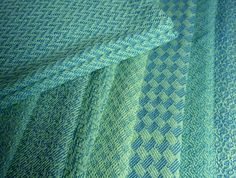 The green-warp/blue-weft dish- (or hand-, or tea-) towels are in the process of being hemmed. Here's a stack of eight of them that are washe...