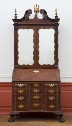 This desk is a leading example of American furniture from the rococo or Chippendale period. Made in Boston, it reflects the sophisticated features associated with the center of furniture production in colonial America. In addition to the many intric...