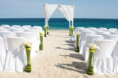 A simple ceremony setup accented by beautiful flowers #DreamsLosCabos