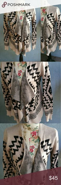"""Tan and Black Aztec Waterfall Cardigan Beautiful and so comfortable, tan and black Aztec design Cardigan Sweater size S. Beautiful waterfall front. Style staple wardrobe must have. Perfect for the upcoming season. 100% Cotton. Flat lay measurements : 27"""" length / 20"""" approx width / 23"""" sleeve length. Please let me know if you have any questions. 30% discount when using the bundle feature. No trades! Goensshopping  Sweaters Cardigans"""