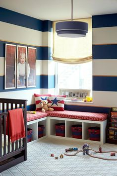 Stars and stripes forever make a bold splash in this boy's nursery where ample floor space and clever storage solutions make it a room that will grow right along with its owner. The built-in bench is a fun, convenient way to bring in extra seating