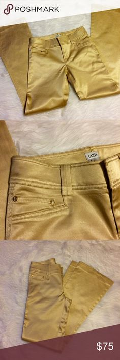 """Caché Gold Bombshell Wide Leg Jeans Amazing gold jeans by Caché in Excellent condition. Just came back from cleaners. Faux pockets in the front and 2 small pockets above them and 2 back pockets. Measures 28"""" waist, 8-1/2"""" rise, 33"""" inseam, 19""""leg Opening. Material: 65% cotton, 33% Rayon, 2% spandex. Cache Jeans Flare & Wide Leg"""