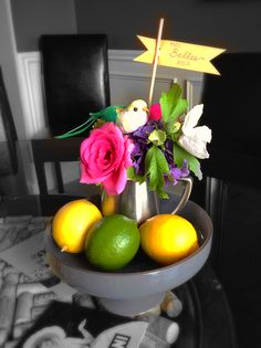 Small garden bouquet and lemon/limes on a cake plate.