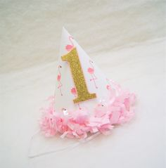 NEW Pink Flamingo Party Hat with Gold Glitter Number - pink tissue fringe trim, flamingo birthday party, gold and pink party by shoplissy on Etsy https://www.etsy.com/listing/278722818/new-pink-flamingo-party-hat-with-gold