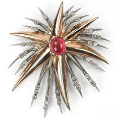 Nettie Rosenstein Sterling Gold Silver and Ruby Cabochon Starburst Pin Clip