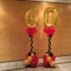 Black Gold and Magenta 60th birthday balloon columns
