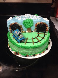Bennett's 3rd birthday cake. Thomas the train theme cake and party.