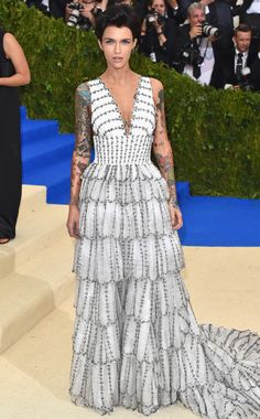 RUBY ROSE   wears a scallopped, tiered custom Burberry gown with Lorraine Schwartz jewelry.