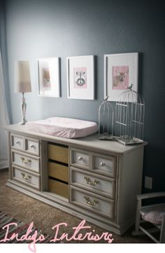 Girls' room / nursery  with blue walls painted in Academy Gray by Valspar. Dresser done in white, gray and gold.