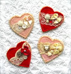 heart brooches. would make for cute little hair clips too.