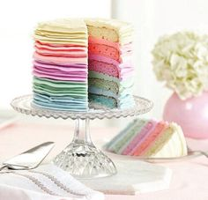 A rainbow cake is fun to look at and eat and a lot easier to make than you might think. Here's a step-by-step guide for how to make a rainbow birthday cake. Pretty Cakes, Cute Cakes, Beautiful Cakes, Amazing Cakes, Pastel Cakes, Pink Cakes, Pastel Party, Slow Cooker Desserts, Gateaux Cake