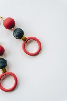 NEW - Modern and minimal polymer clay earrings. Soft red and black marble. Simple every day accessory.