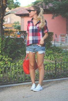 Plaid shirt, shorts, and white Converse.