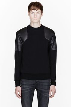 TIM COPPENS //  Black leather-shouldered sweatshirt  32489M055002  Long sleeve sweatshirt in black. Ribbed crewneck collar, cuffs, and hem. Padded leather paneling at shoulders with tonal bias trim. Tonal leather paneling at upper arms. Tonal stitching. Body: 100% cotton. Fabric 2: 100% bonded lamb leather. Fabric 3: 100% lamb leather. Dry clean. Made in United States.  $625 CAD