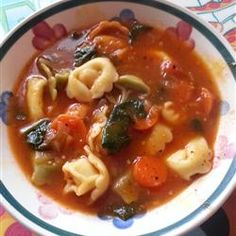 "Italian Sausage Soup with Tortellini - ""This soup embodies all the wonders of Italian cooking: Italian sausage, garlic, tomatoes and red wines. Serve with hot bread and salad for a delicious meal. Garnish with Parmesan cheese."""