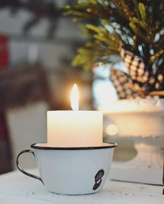 candle in enamelware mug pretty and practical
