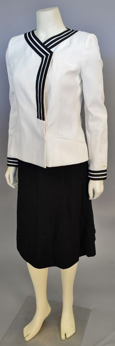 """Lot 459: Chanel two piece suit, ivory matelasse jacket with black stripe trim and black skirt (waist approximately 26""""). #Nadeausauction #Socialite #Luxurycouture #vintagecouture #vintagefashion"""