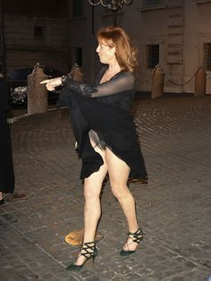 Sarah, Duchess of York suffered an unfortunate wardrobe malfunction while leaving the Quirinale building after a cocktail party, when the hem of her black dress got caught in her sleeve, revealing her black underwear, Oops!
