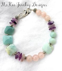 Pastels. Purple, pink and blue stone with silver metal bracelet.
