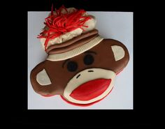 i'm obsessed.  i mean, would a plain old sheet cake with a buttercream sock monkey be so bad?