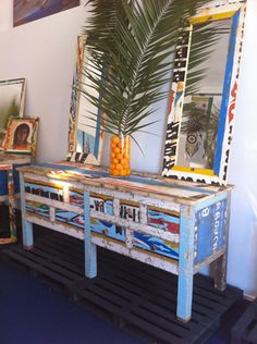 Oooo!  I want this!!!  Upcycled furniture made from West African fishermen boats.