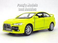 The 2008 Mitsubishi 2008 Lancer Evolution at 1/36 scale by Kinsmart measures about 5 inches long by about 2 inches wide by about 2 inches high. It has very nice details such as separate clear plastic
