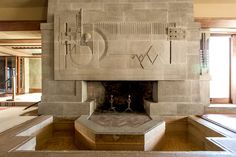 Frank Lloyd Wright's First LA House, Restored to Its 1920s' Beauty - Hollyhock House . . . The bas relief fireplace.
