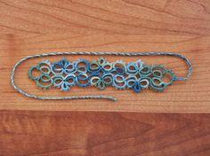 J'ai voulu tester une nouvelle couleur de fil (Lizbeth Blue River Glades, #164) avec ce marque-page créé par Kersti. Le modèle est nommé Tabatha. J'aime vraiment beaucoup cette couleur. :) Le modèl...