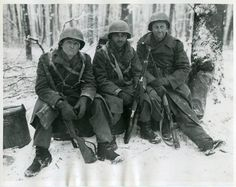 3 GI's rest in the Ardennes forests Dec. 1944