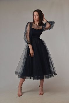 Planning a Halloween wedding? Or just love the edgy look of a short black wedding dress? We've rounded up 32 of our favorite black wedding dresses that will totally make a statement on your wedding day. Say hello to the prettiest black wedding gowns you've ever seen. White Tulle Dress, Blue Midi Dress, Lace Dress, Black Wedding Dresses, Wedding Dress Styles, Puffy Dresses, Engagement Dresses, Dress Cuts, Simple Dresses