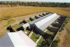Luxury Dog Boarding Kennels | Office Building Aerial View NB the use of embankments up to each dog runs wall to reduce sound travel