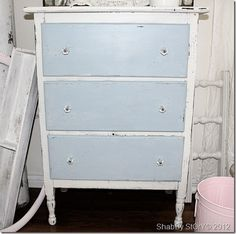 shabby distressed dresser with blue drawer and glass knobs