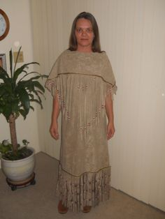 This is one style that can be made out of buckskin (shown here in a faux suede) It's a 2 piece set with sundress and matching cape/yoke fully fringed and adorned with beads as shown here.