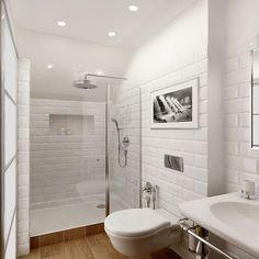 Cette petite salle de bain mise tout sur sa douche aménagée dans le coin de la pièce.