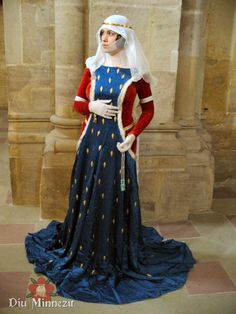 Mid 14th - early 15th c look. Too long in front! Like the bling- it could be personal or kingdom. Having a plain cotehardie would be a useful wardrobe piece. I like the veils.