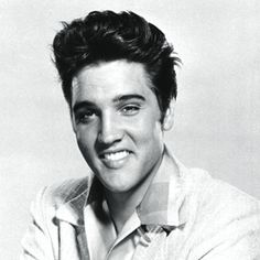 In this picture you see a photo of Elvis Presley, also known as 'The King of Rock'. He was very famous around the whole world.He seperated himself from the other singers by being white and singing with a 'black' voice. Also his style was very different like his long whiskers and clothing. Elvis was a role model for people, because he wanted to be unique and different than everyone else.