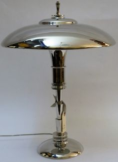 """A Faries """"Guardsman"""" lamp, stated to be nickel, made by Merkel (? H 48 cm, diameter 36 cm. Asking price is USD Oh to be rich. Lamps, Table Lamp, Interior Design, Lighting, Antiques, Home Decor, Lightbulbs, Nest Design, Antiquities"""