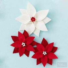 Fall in love with the look of festive red and white poinsettias popping against your dark evergreen Christmas tree. Bonus: Make the ornaments without hanging loops to use as Christmas present decorations.