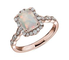 This beautiful emerald cut opal is paired with rose gold and encased in a diamond halo for a unique and romantic look. Non Diamond Engagement Rings, Engagement Ring Styles, Vintage Engagement Rings, Vintage Opal Rings, Solitaire Engagement, Opal Wedding Ring Set, Wedding Bands, Halo Diamond, Just In Case