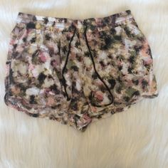 Fabric shorts Abstract fabric shorts. One bead missing on the drawstring as pictures. Charlotte Russe Shorts