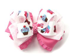 Cupcake Couture Girls Hair Bow - A pretty little cupcake hairbow featuring bubblegum pink ruffle ribbon, a double layer of chiffon and our signature cupcake top ribbon.   www.PinkBowtique.com