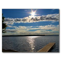 Pushaw Lake Mid-Morning Sunrise Postcard (Pkg of 8) by KJacksonPhotography --  Taken 08.23.2014 The sun rising mid morning over Pushaw Lake at Lakeside Landing in Glenburn, Maine. The sparkly rays of the sun highlight the lake beside the dock as the white and yellowish clouds drift lazily in the blue skies. PC:178.214 #nature #photography #sunrise #lake #naturephotography #postcard #postcards