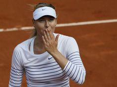 Russia's Maria Sharapova celebrates after winning her match against Estonia's Kaia Kanepi during the women's first round of the Roland Garros 2015 French Tennis Open in Paris on May 25, 2015.