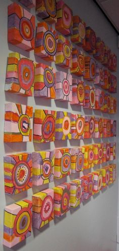 Primary 4 children have been busy making a permanent installation in the entrance hall....48 little box canvases