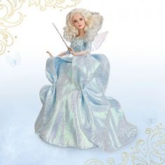 The Cinderella Film Collection Fairy Godmother doll wears a sparkling iridescent satin gown.